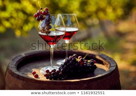 Rode wijn glas zonsondergang mooie wijn zee Stockfoto © kenishirotie