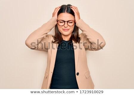 Genç esmer işkadını gözlük baş ağrısı ağrı Stok fotoğraf © sebastiangauert