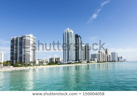 beautiful beach with condominiums and skyscraper in Sunny Island Stock photo © meinzahn