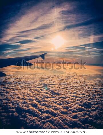 napfelkelte · repülőgépek · szárny · ablakok · felhőkép · üzlet - stock fotó © meinzahn