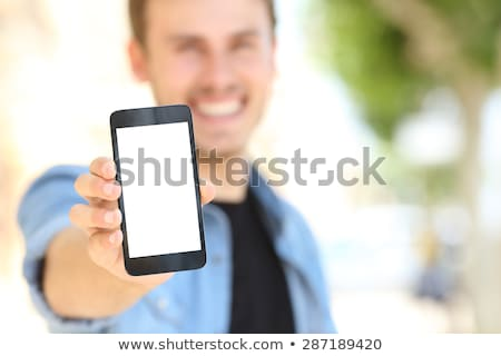 Hand holding generic mobile phone with blank screen Stock photo © stevanovicigor