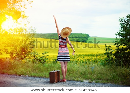 Foto stock: Woman In Green Dress Standing With Hat In Hand In Old Retro Cit