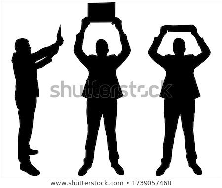 Stock photo: silhouette of man raising his hands