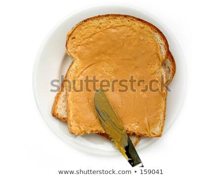 Арахисовое масло ломтик свежие хлеб деревянный стол Сток-фото © sarahdoow