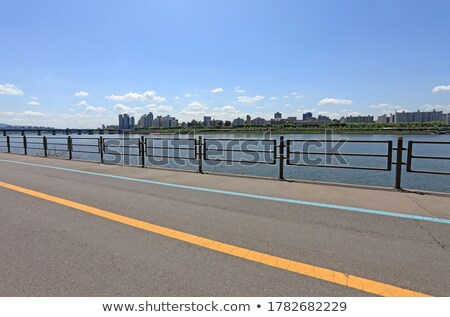 Empty bicycle road along the river Stock photo © simply