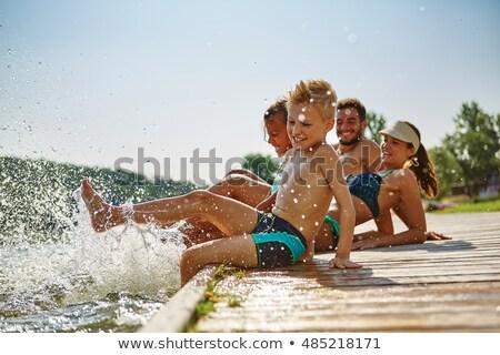 Gyermek fürdik tenger boldog tengerpart víz Stock fotó © Mikko