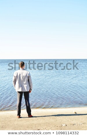 Young businessman with flower resting outdoors in sunny day.  Stock photo © deandrobot