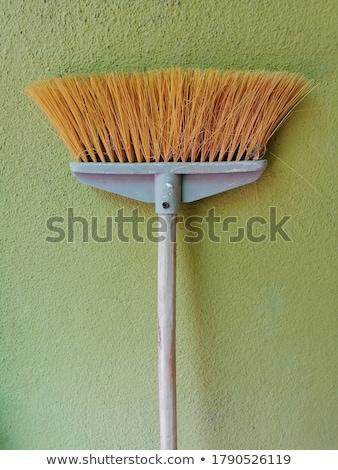 Household Broom For Floor Cleaning Leaning on Brick Wall Stock photo © stevanovicigor