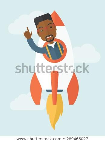 Black young guy inside the rocket. Stock photo © RAStudio