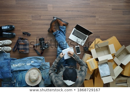 fashion business man sitting on wood boxes Stock photo © feedough