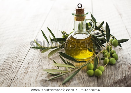 OLive oil and olives wooden table Stock photo © marimorena