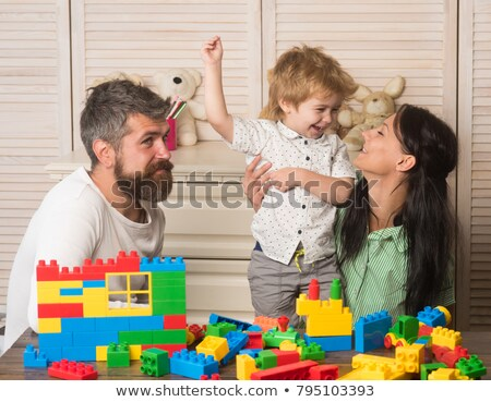 mother and father with child in playroom Stock photo © Paha_L