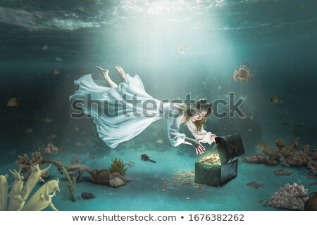 Swimming in wealth Stock photo © alphaspirit