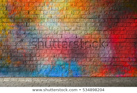 Colorful paint sprayed brick wall Stock photo © stevanovicigor