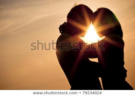 Siluet çift sevmek gün batımı kadın gökyüzü Stok fotoğraf © koca777