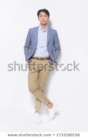 arrogant elegant man in double breasted suit standing Stock photo © feedough