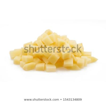Nyers krumpli halom vágódeszka zöldség senki Stock fotó © Digifoodstock