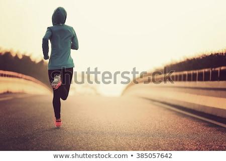 Manana ejecutar joven playa ritmo cardíaco mujer Foto stock © adam121
