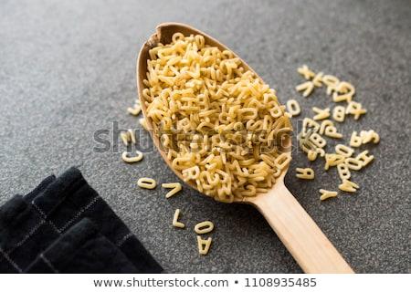 ábécé tészta tányér szürke hely közelkép Stock fotó © Digifoodstock