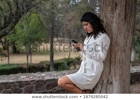 Mulheres celular árvore mulher tecnologia Foto stock © IS2