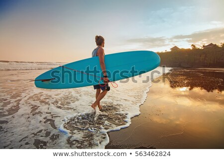Man carrying surfboard on beach Stock photo © IS2