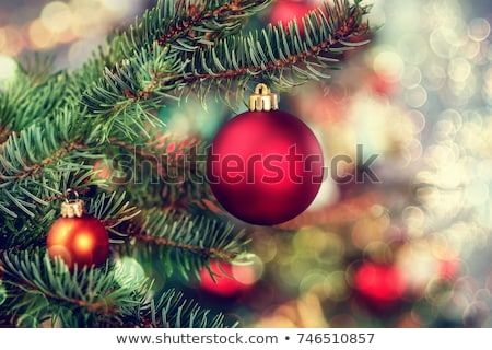Red christmas bauble on wooden table Stock photo © wavebreak_media