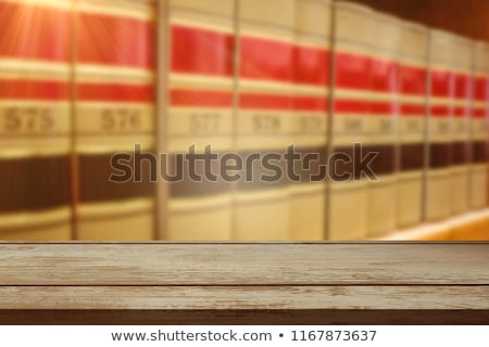 Surface of wooden plank against close up of a bookshelf stock photo © wavebreak_media