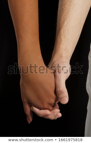 Man holding female hand in the act of violence Stock photo © boggy