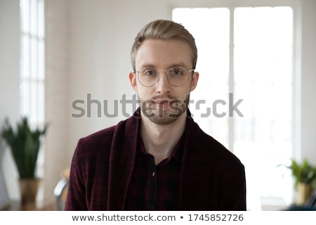 smiling confident businessman stock photo © kzenon