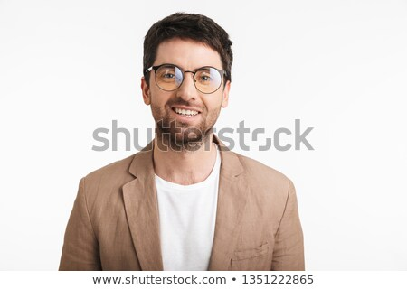 Beautiful unshaved man 30s in white shirt looking on camera, iso Stock photo © deandrobot