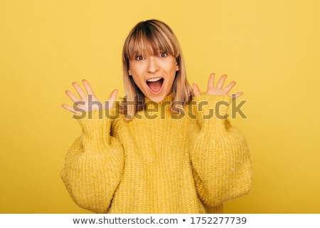 young cute woman posing isolated over yellow background showing hopeful please gesture stock photo © deandrobot