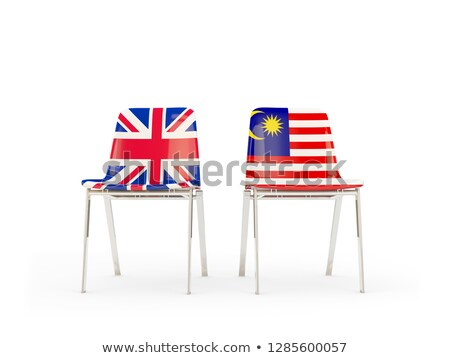 Two chairs with flags of UK and malaysia isolated on white Stock photo © MikhailMishchenko