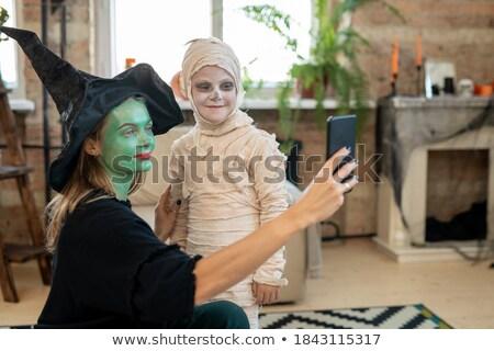 Derűs nő boszorkány néz kamera tart Stock fotó © deandrobot