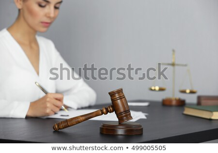 mallet and gavel on the businesswomans desk stock photo © andreypopov