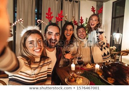 happy family taking selfie at christmas dinner stock photo © dolgachov