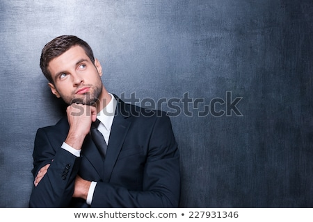 Man Day Dreaming Against White Background Stock photo © AndreyPopov