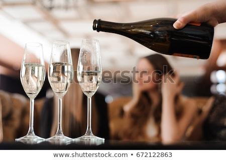 mosolyog · pincér · felajánlás · tálca · szemüveg · pezsgő - stock fotó © dolgachov