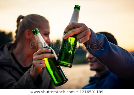close up of woman with green beer in glass stock photo © dolgachov