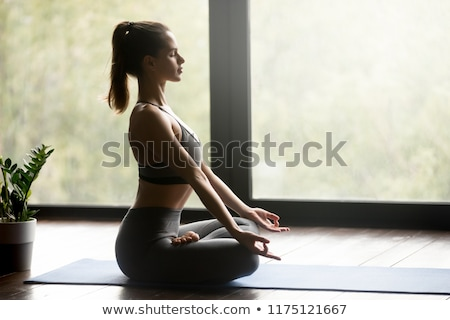 Lady in Siddhasana posture , top view Stock photo © lichtmeister