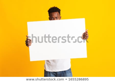 Young Man Holding Big Orange Advertising Poster Stock photo © robuart