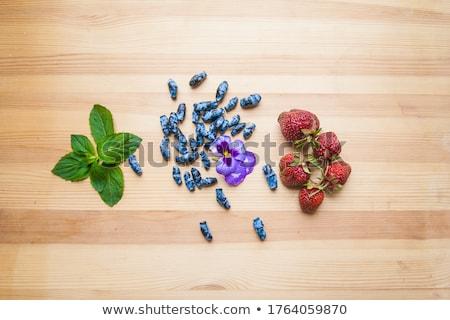Wild strawberries and Blue Honeysuckle Berries wood background Stock photo © galitskaya