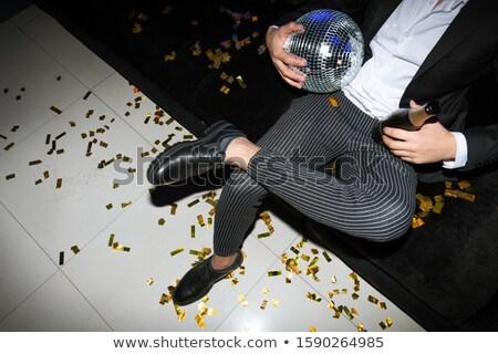 Benen elegante man disco ball fles champagne Stockfoto © pressmaster