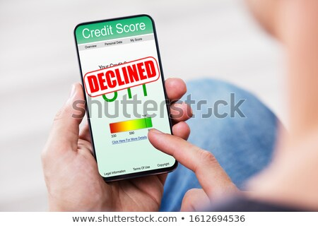 Person Checking Credit Score On Mobile Phone At Home Stock photo © AndreyPopov
