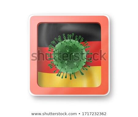 Model of Coronavirus on the background of German flag. Stock photo © artjazz