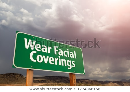 SARS-CoV-2 Coronavirus Green Road Sign Against Ominous Stormy Cl Stock photo © feverpitch