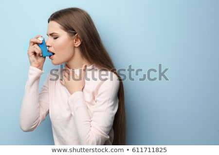 Girl with asthma inhaler Stock photo © Lopolo