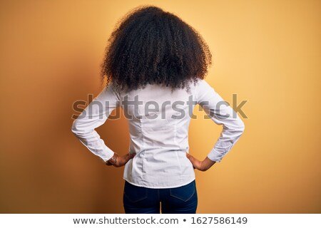 Image from back of african american woman posing with hands on her waist Stock photo © deandrobot