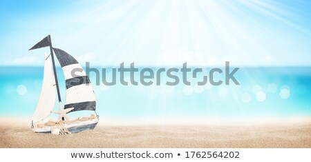 Summer tropical sea with sparkling waves and sailing ship toy Stock photo © karandaev