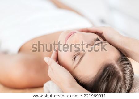 Belo mulher jovem massagem retrato cara mãos Foto stock © jaykayl