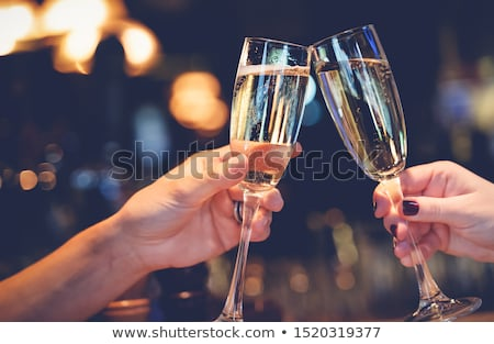 two women drinking sparkling wine at restaurant stock photo © photography33